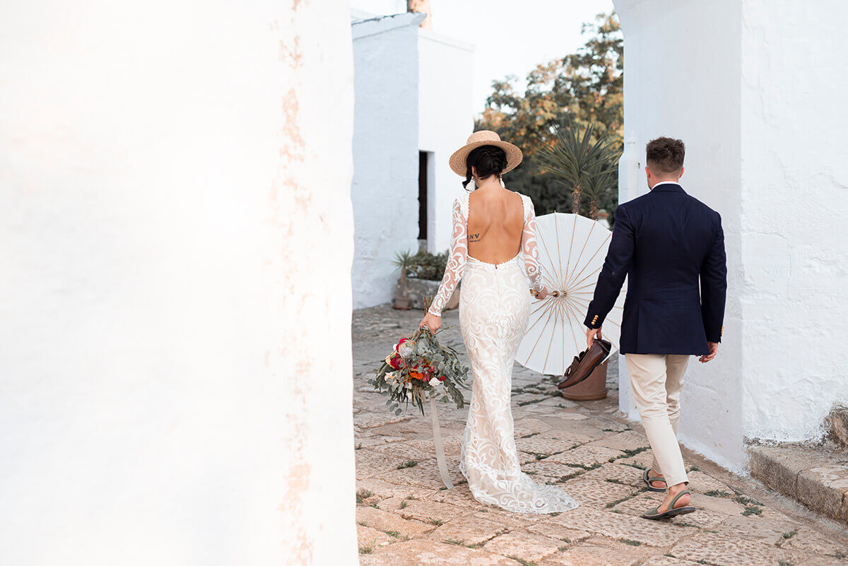 Wedding photograph of bride in a hat in Ostuni Italy
